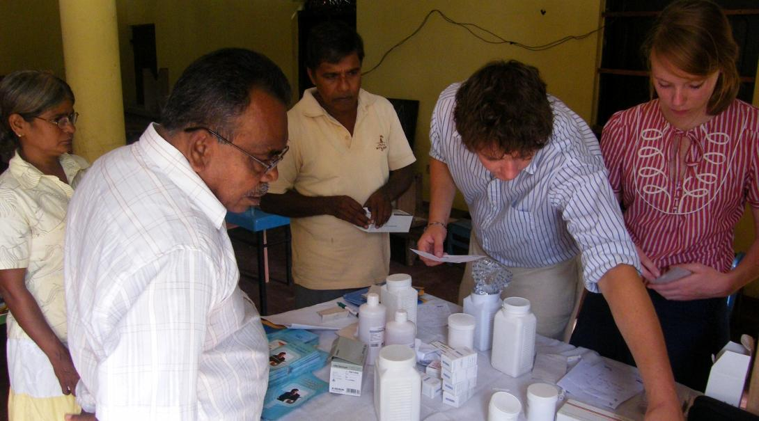 Interns and doctors are seen handing out prescriptions to local residents as part of their pharmacy internship in Sri Lanka.